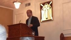 Dr. Carl Trueman behind the pulpit of Mid-Cities Presbyterian Church.